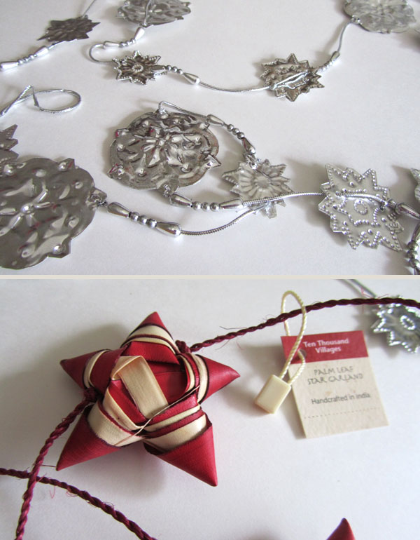 Close-up of silver snowflake garland and red star garland