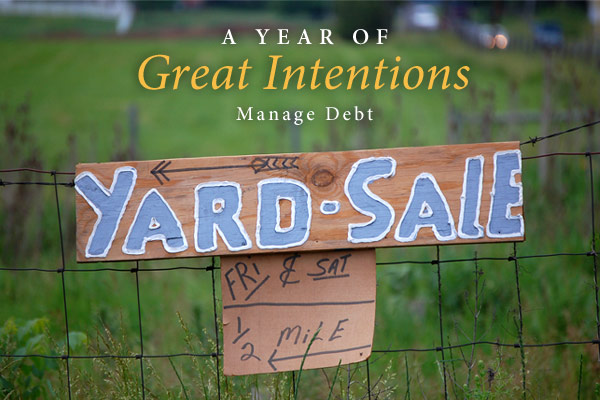 A Year of Great Intentions: Manage Debt | Photo of yard sale sign on a fence
