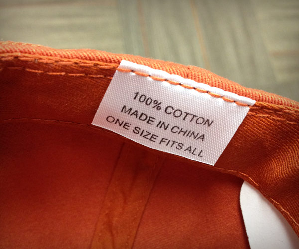 "Image of tag inside baseball cap that reads ""Made in China"""