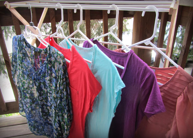 Photo of thrift store shirts hanging on clothes rack