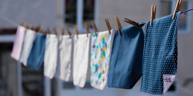 Several handkerchiefs hanging on an outdoor clothesline