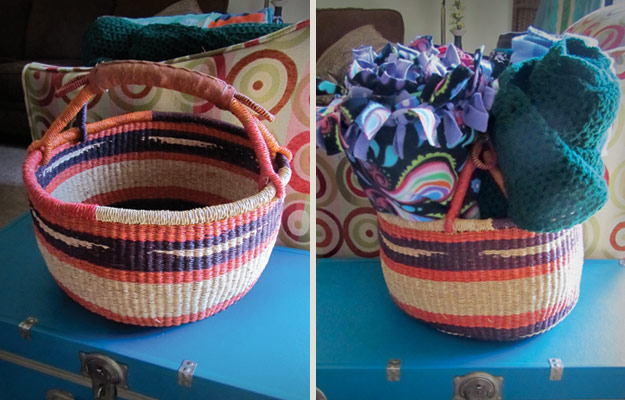 Basket with leather handles holding blankets