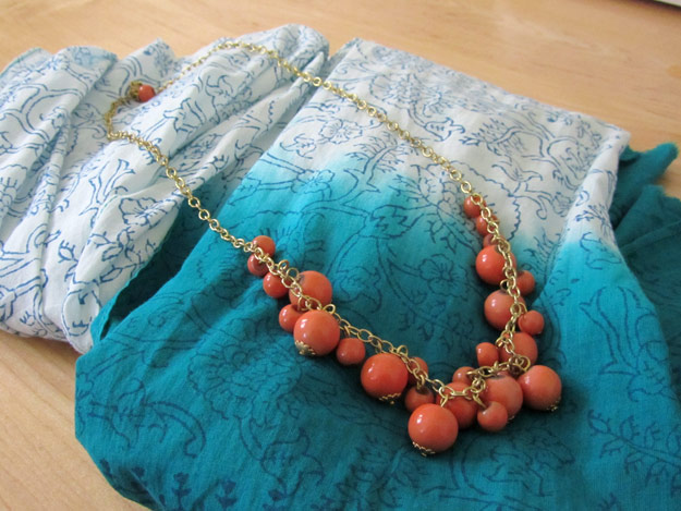 Teal-to-white ombre scarf and coral beaded necklace