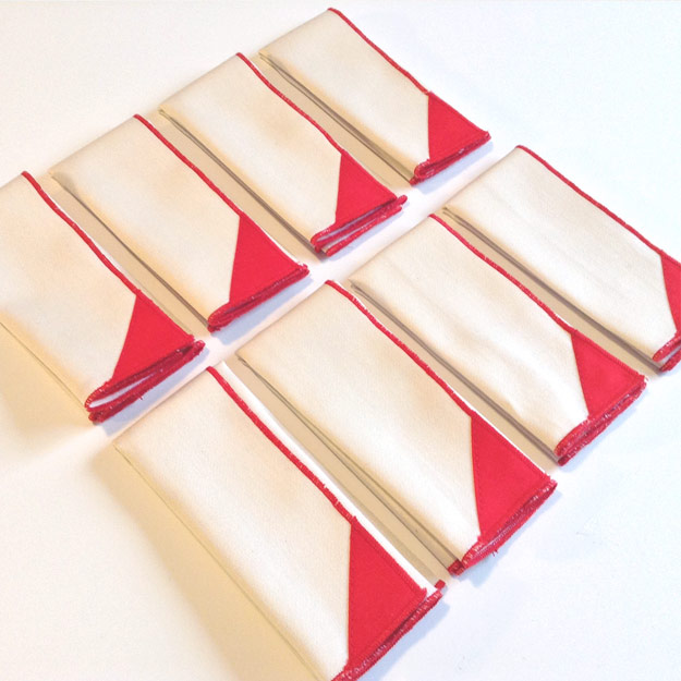 Eight natural handkerchiefs with red corners
