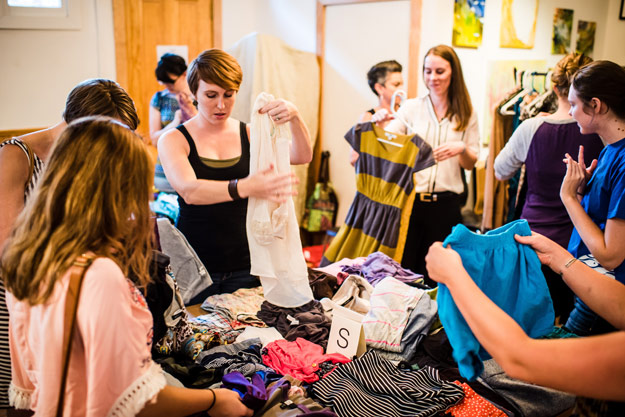 Swappers browse clothes on a table