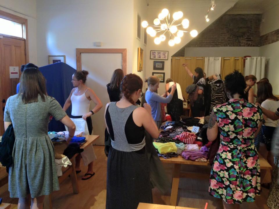 Women browsing clothing at New Day Craft
