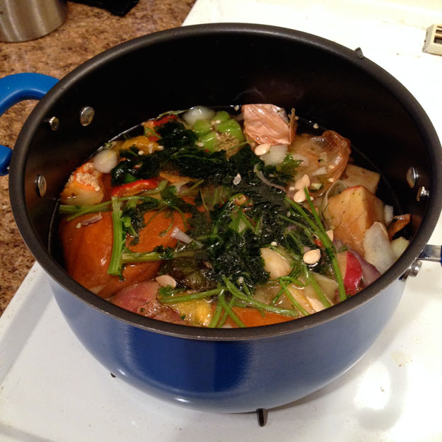 Vegetable scraps in pot with water