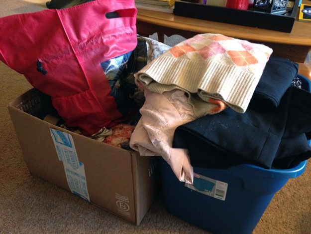 Two boxes overflowing with clothes