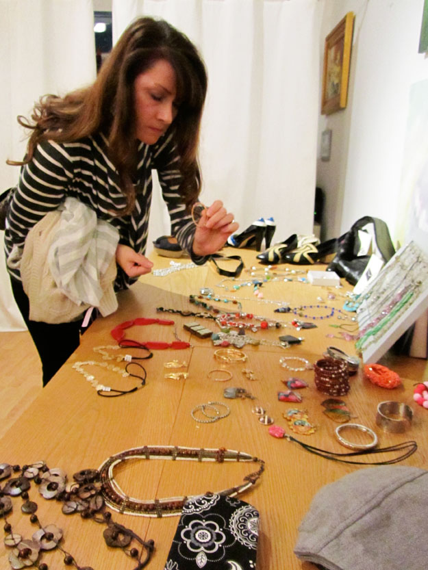 Woman peruses jewelry table