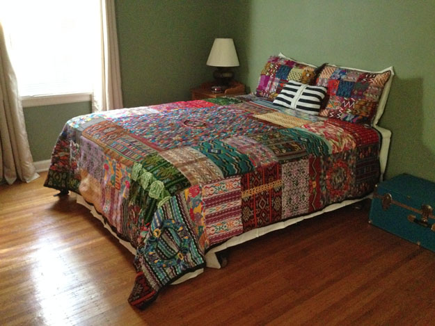 Bed with Guatemalan fair trade quilt